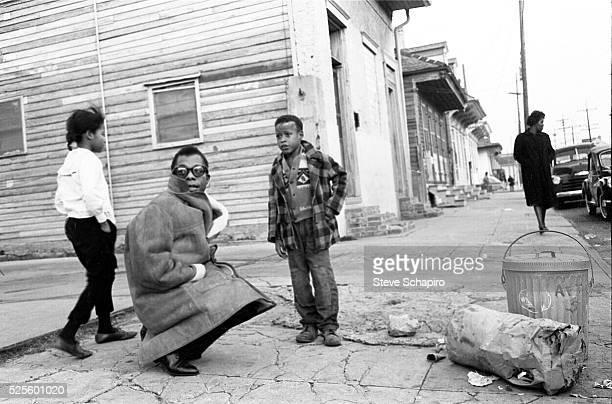 Writer James Baldwin with children in New Orleans