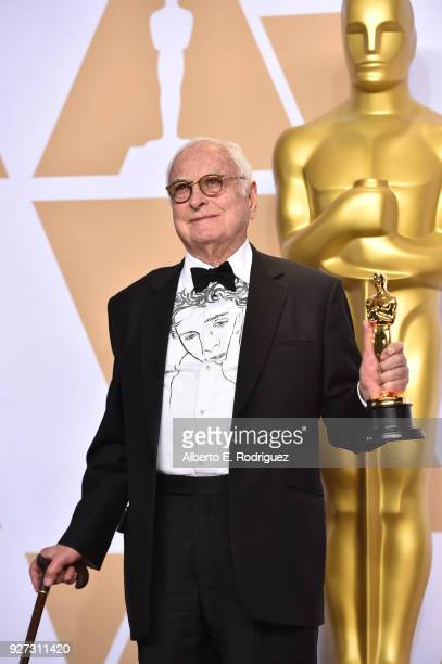 Writer James Ivory winner of the Best Adapted Screenplay award for 'Call Me By Your Name' poses in the press room during the 90th Annual Academy...