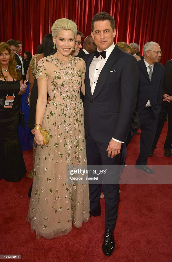 Writer Jason Hall (R) and Elisha Hall attend the 87th Annual Academy Awards at Hollywood & Highland Center on February 22, 2015 in Hollywood, California.