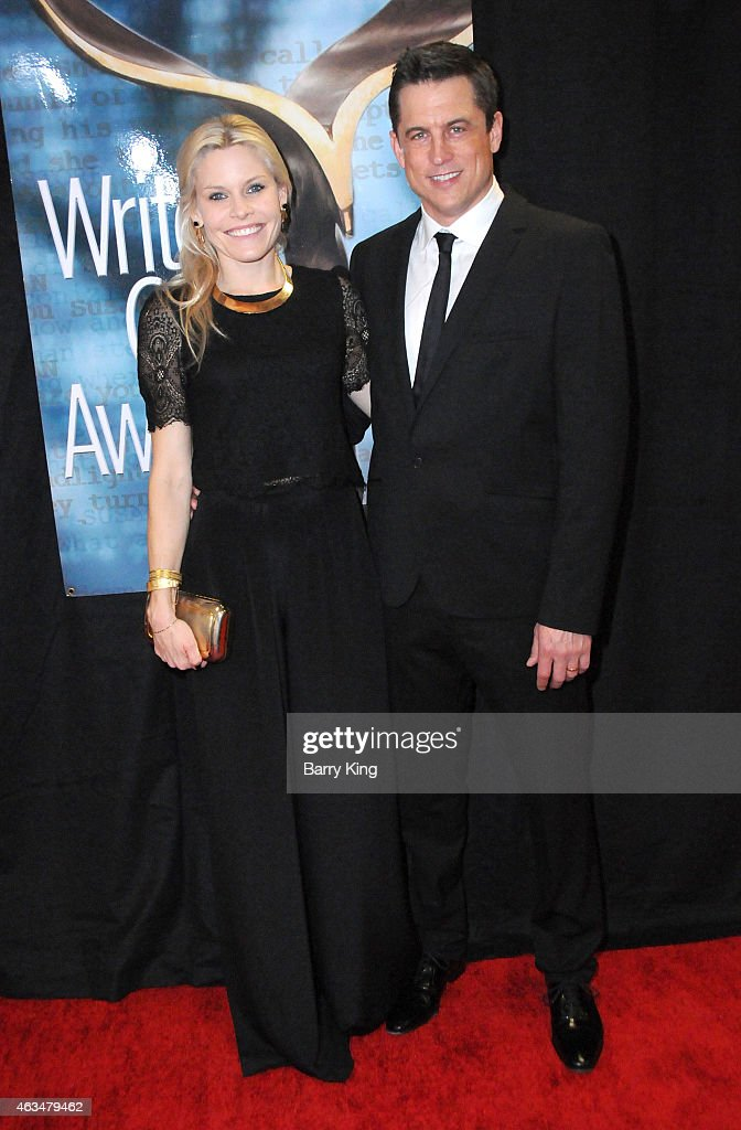 Writer Jason Hall (R) and wife Elisha Hall arrive at the 2015 Writers Guild Awards at the Hyatt Regency Century Plaza on February 14, 2015 in Los Angeles, California.