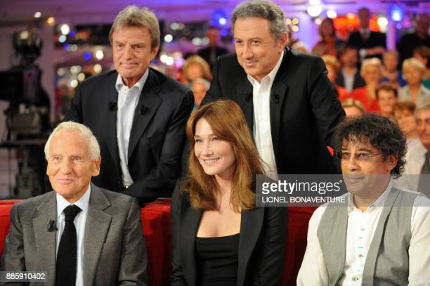 Writer Jean d'Ormesson France's Foreign Minister Bernard Kouchner France's first Lady Carla BruniSarkozy TV host Michel Drucker and singer Laurent...