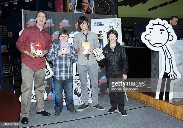 Writer Jeff Kinney and actors Robert Capron Devon Bostick and Zach Gordon attend the Planet Hollywood Times Square on March 16 2011 in New York City