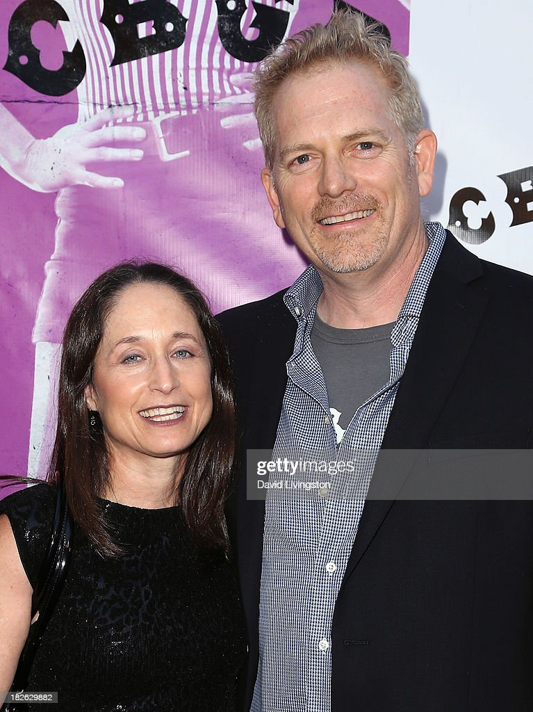 Writer Jody Savin (L) and director Randall Miller attend a screening of Xlrator Media's 'CBGB' at ArcLight Cinemas on October 1, 2013 in Hollywood, California.