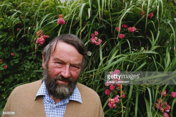 Writer John Fowles poses at his home in Lyme Regis in Dorset England on August 10 1985