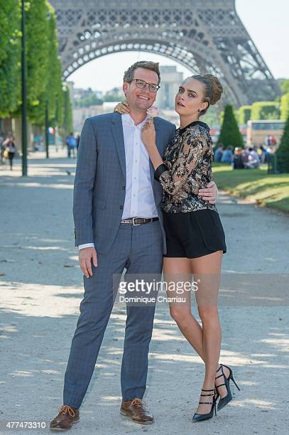 """Writer John Green and model Cara Delevingne attend the Paper Towns """" La Face Cachee De Margo """" Photocall In Paris on June 17, 2015 in Paris, France."""