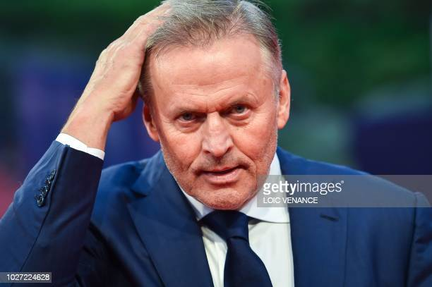 US writer John Grisham poses on the red carpet before the screening of the movie Adrift as part of the 44th Deauville US Film Festival in Deauville...