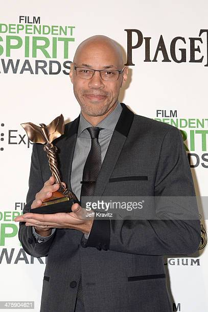 Writer John Ridley poses with the award for Best Screenplay for 12 Years a Slave in the press room during the 2014 Film Independent Spirit Awards on...