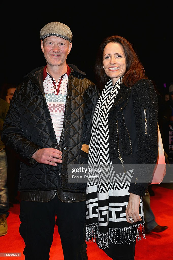 Writer Jonathan Asser and guest attend a screening of 'Starred Up' during the 57th BFI London Film Festival at Odeon West End on October 10, 2013 in London, England.