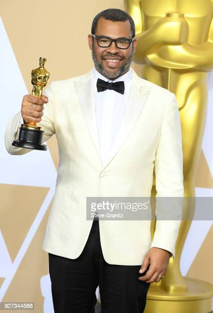 Writer Jordan Peele winner of the Best Original Screenplay award for 'Get Out' poses in the press room during the 90th Annual Academy Awards at...