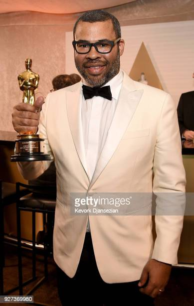 Writer Jordan Peele winner of the Best Original Screenplay award for 'Get Out' poses with award at the 90th Annual Academy Awards Governors Ball at...