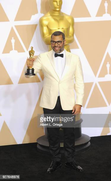 Writer Jordan Peele winner of the Best Original Screenplay award for 'Get Out' poses inside the Press Room of the 90th Annual Academy Awards held at...