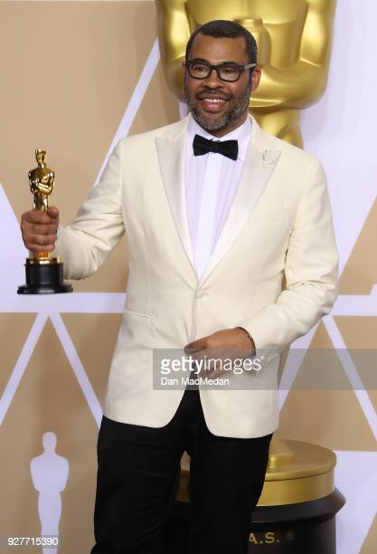 Writer Jordan Peele winner of the Best Original Screenplay award for 'Get Out' poses in the press room at the 90th Annual Academy Awards at Hollywood...