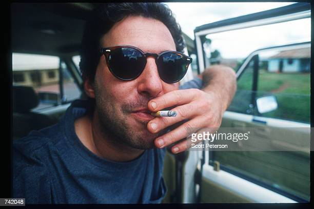 Writer Josh Hammer of Newsweek enjoys a cigarette June 1994 in Rwanda Wellknown journalists descended on Rwanda during and after the genocide