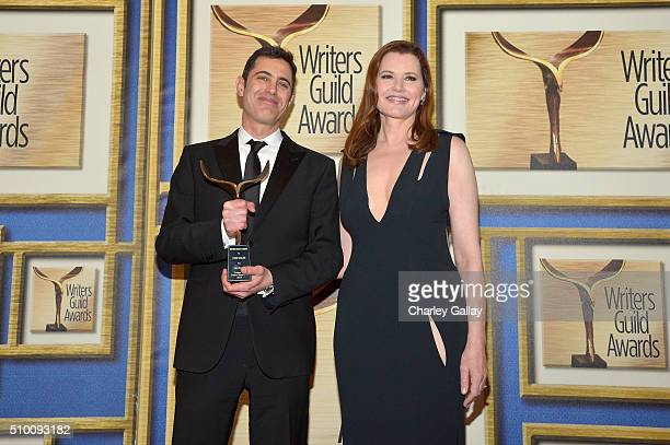Writer Josh Singer cowinner of the Original Screenplay award for 'Spotlight' and actress Geena Davis pose in the Press Room during the 2016 Writers...