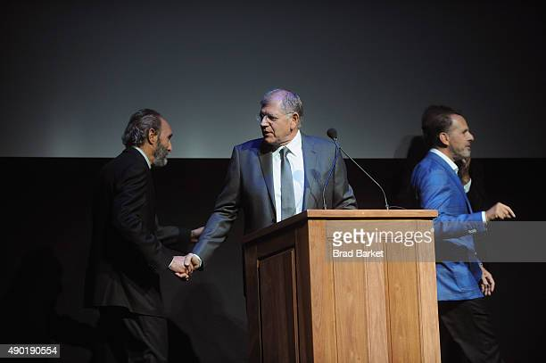 Writer Kent Jones and director Robert Zemeckis greet each other on stage at the Opening Night Gala Presentation and 'The Walk' World Premiere during...