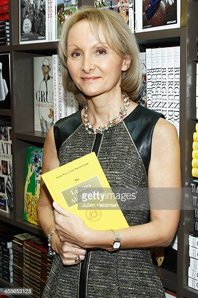 Writer Ketty PucciSisti Maisonrouge poses with her book during 'The Luxury Alchemist' Book Launch Cocktail At Assouline Boutique on December 12 2013...