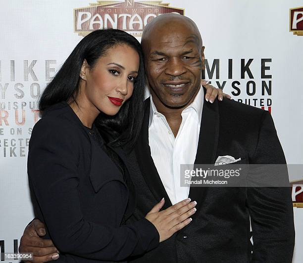 Writer Kiki Tyson and Mike Tyson attend the Los Angeles Premiere of Mike Tyson Undisputed Truth at the Pantages Theatre on March 8 2013 in Hollywood...