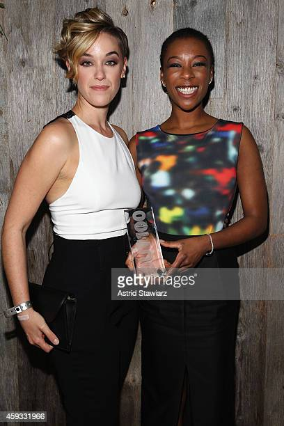 Writer Lauren Morelli and actress Samira Wiley attend Out100 2014 presented by Buick on November 20 2014 in New York City