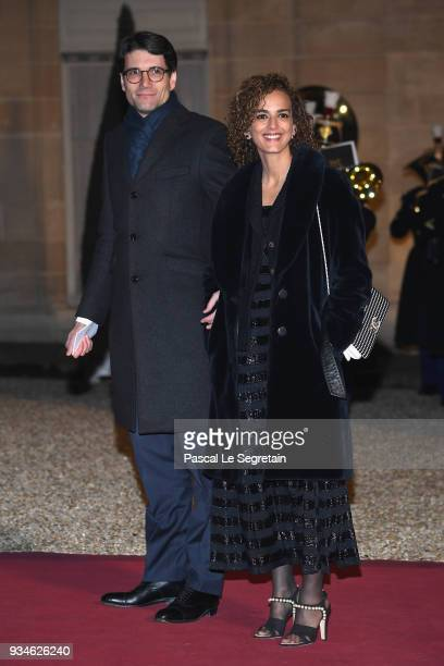 Writer Leila Slimani and a guest attend a State dinner hosted by French President Emmanuel Macron and Brigitte Macron at the Elysee Palace on March...