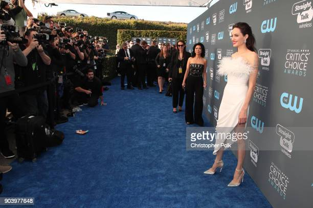 Writer Loung Ung and actor/director Angelina Jolie attend The 23rd Annual Critics' Choice Awards at Barker Hangar on January 11 2018 in Santa Monica...