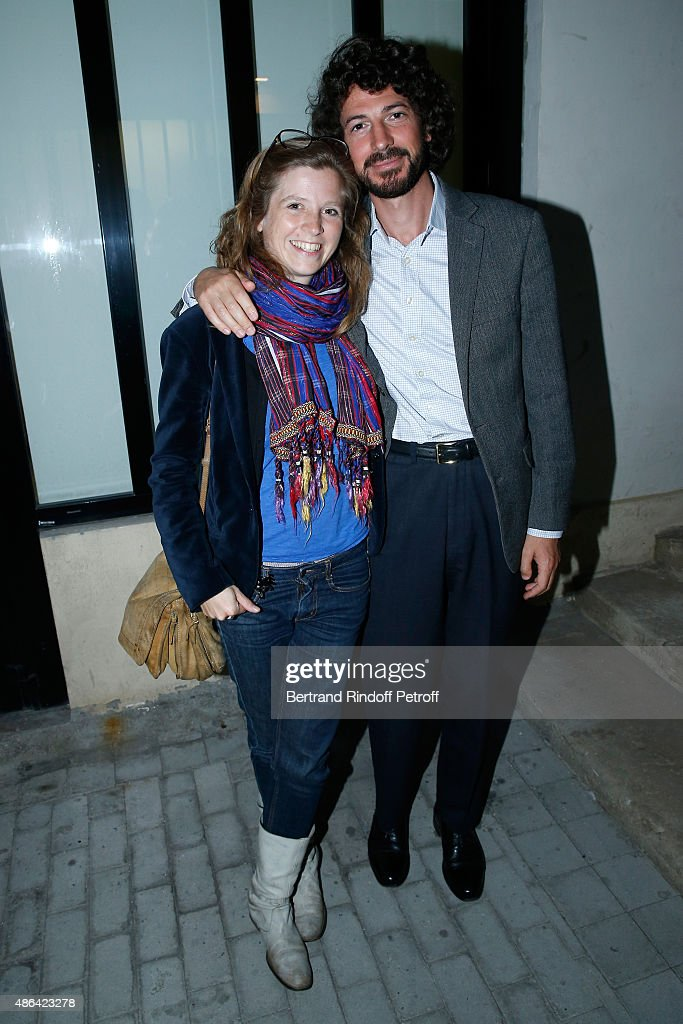 Writer Mael Renouard (R) with his Companion Editor in Chief of 'Art Press' Anael Pigeat attend the 'World Press Photo 2015' Exhibition Opening Party, held at Galerie Azzedine Alaïa on September 3, 2015 in Paris, France.