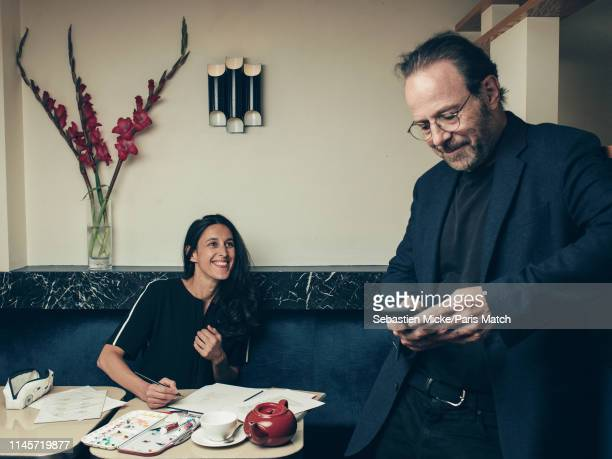 Writer Marc Levy with his wife Pauline Leveque are photographed for Paris Match on May 9 2019 in New York United States