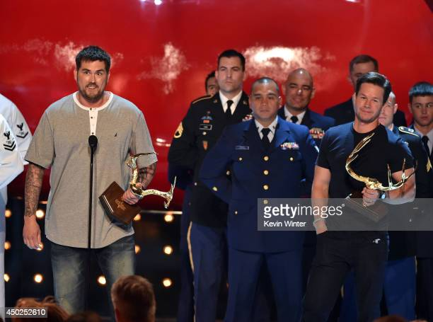 Writer Marcus Luttrell accepts the Troops Choice award onstage during Spike TV's Guys Choice 2014 at Sony Pictures Studios on June 7 2014 in Culver...