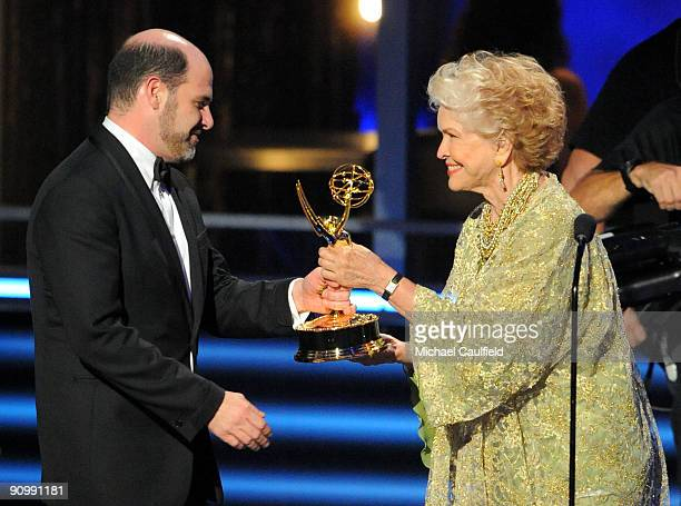Writer Matthew Weiner accepts an award from actress Ellen Burstyn onstage at the 61st Primetime Emmy Awards held at the Nokia Theatre on September...