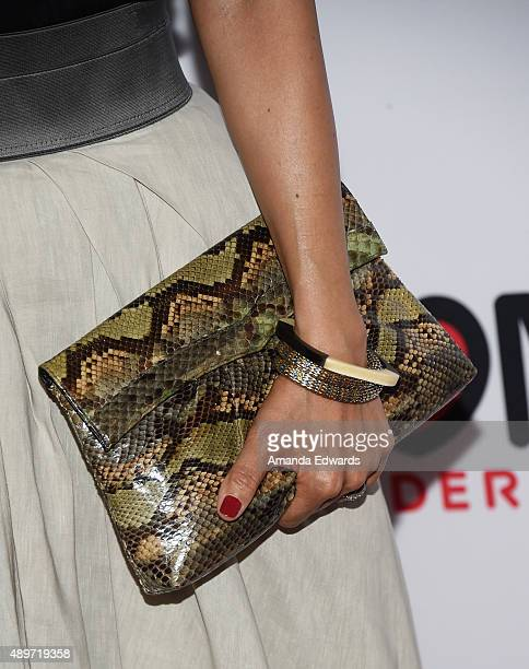 Writer Maurissa Tancharoen clutch and bracelet detail arrives at the premiere of Marvel's 'Agents Of SHIELD' at Pacific Theatres at The Grove on...
