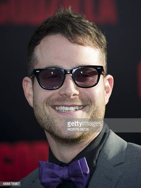 Writer Max Borenstein smiles as he arrives for the Los Angeles movie premiere of 'Godzilla' on May 8 2014 at the Dolby Theatre in Hollywood...