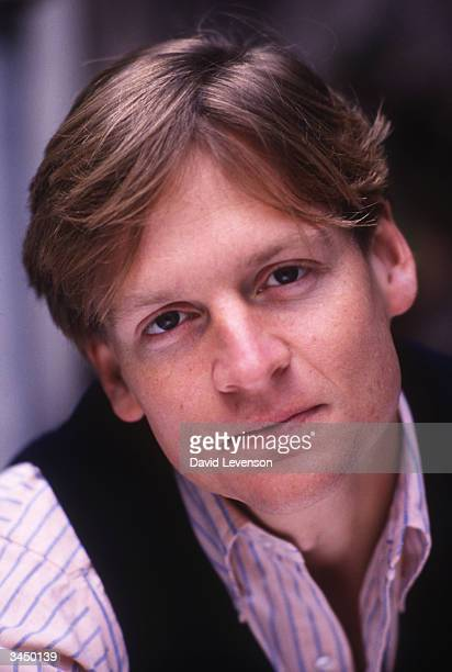 Writer Michael Lewis poses at his home in Hampstead in London England on October 14 1989