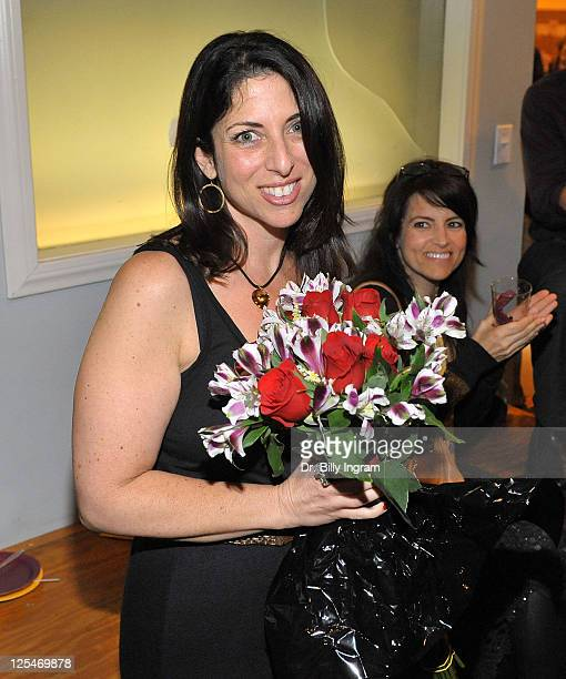 Writer Michelle Kholos Brooks receives flowers at the after party for the Open Night Premiere of the Play Love And Other Allergies at the Lounge...