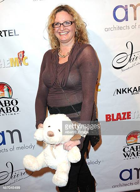 Writer Mo Whelan attends Britticares Toy Drive with a benefit concert by G Tom Mac Many Of Odd Nature in conjunction with publicist Michael Arnoldi's...