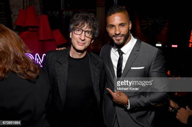 Writer Nail Gaiman and actor Ricky Whittle attend the American Gods premiere after party at TAO Asian Bistro on April 20 2017 in Los Angeles...