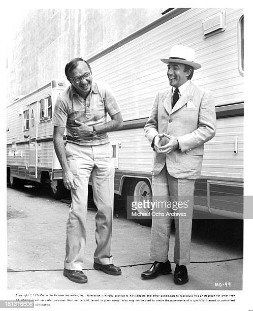 Writer Neil Simon and actor Peter Sellers behind the set of Columbia Pictures movie Murder by Death in 1976