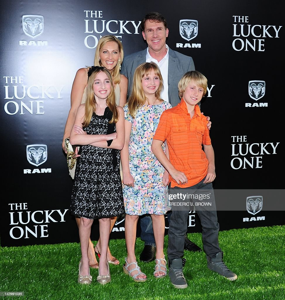 Writer Nicholas Sparks and family pose on arrival for the ...