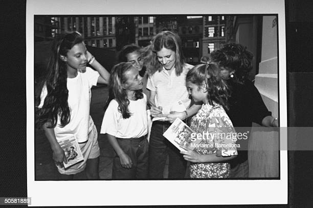 Writer of preteen novels The BabySitters Club series Ann Martin signing autographs for daughters of employees of her publishing house Scholastic Inc