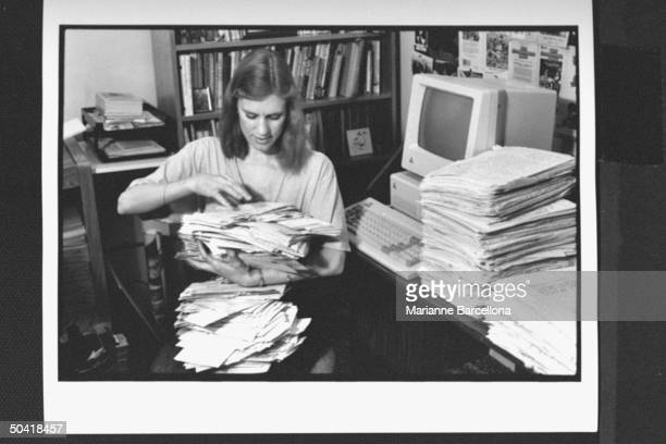 Writer of preteen novels The BabySitters Club series Ann Martin going through stacks of fan mail at home Greenwich Village