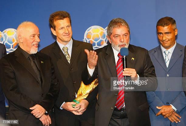 Writer Paolo Coelho Brazilian National Football Coach Dunga and Romerio listen as Brazilian President Luiz Inacio Lula da Silva talks after the FIFA...