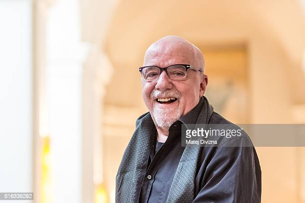 Writer Paolo Coelho poses for photographers after a press conference on March 18 2016 in Prague Czech Republic