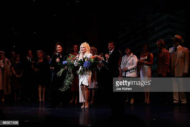 Writer Patricia Resnick singer Dolly Parton on stage during curtain call at the opening of 9 to 5 The Musical on Broadway at the Marriott Marquis...