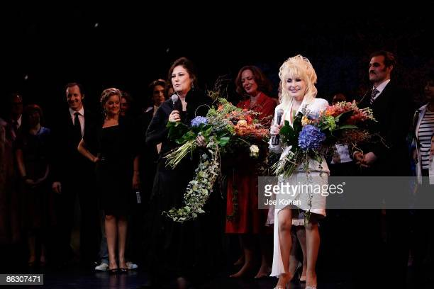 Writer Patricia Resnick singer Dolly Parton on stage during curtain call at the the opening of 9 to 5 The Musical on Broadway at the Marriott Marquis...