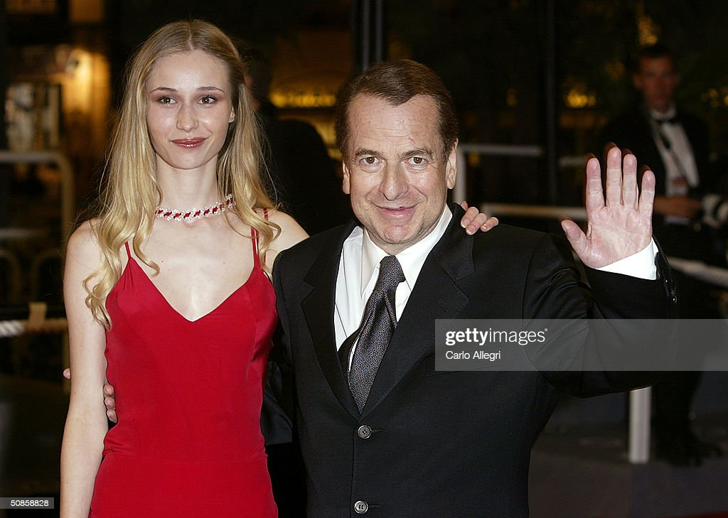 Writer Paul Loup Sulitzer and guest attend the premiere of 'House of Flying Daggers' atthe Palais de Festival during the 57th Annual International Cannes Film Festival May 19, 2004 in Cannes, France.