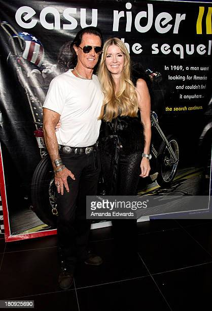 Writer Phil Pitzer and actress Jodie Fisher attend the Easy Rider The Ride Back 'RideIn' premiere at Bartels' HarleyDavidson on September 17 2013 in...