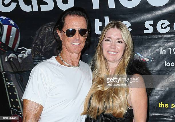 Writer Phil Pitzer and Actress Jodie Fisher attend the screening of Easy Rider The Ride Back 'RideIn' at Bartels' HarleyDavidson on September 17 2013...