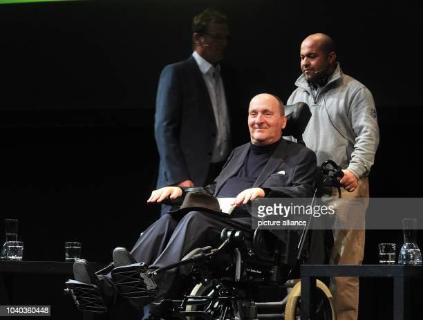 Writer Philippe Pozzo di Borgo and his nurse and friend Abdel Sellou are pictured during a reading of di Borgo's book 'Rather Vulnerable Rather...