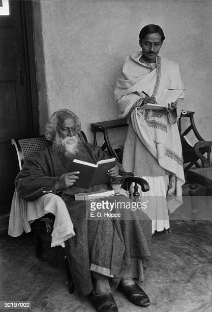 Writer Rabindranath Tagore dictates to his secretary at his university Visva Bharati in Santineketan West Bengal India 1929