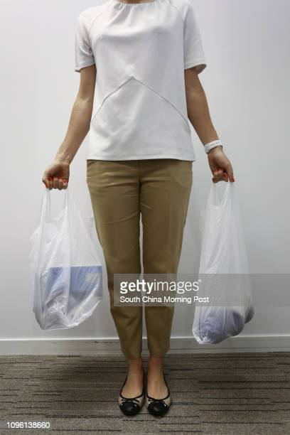 Writer Rachel Jacqueline shows the correct way to carry a shopping bags at Prohealth Sports and Spinal at Jardine House in Central 21MAR16 [LIFE...