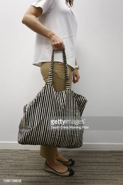 Writer Rachel Jacqueline shows the incorrect way to carry a bag at Prohealth Sports and Spinal at Jardine House in Central 21MAR16 [LIFE HEALTH]...