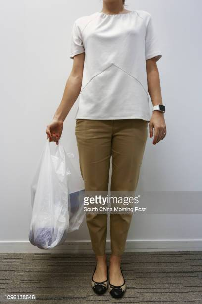 Writer Rachel Jacqueline shows the incorrect way to carry a shopping bags at Prohealth Sports and Spinal at Jardine House in Central 21MAR16 [LIFE...